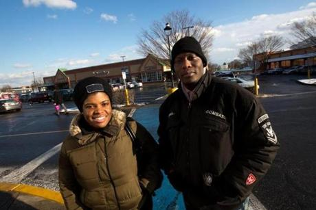 """It will help the tourists, but it won't help us,"" said Isaiah Poole of Dorchester, seen with Leilani Cummins."
